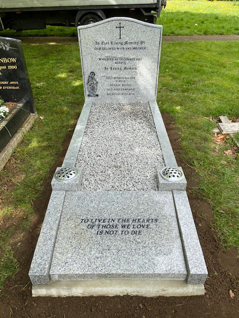Full kerb memorial with inscription panel to foot.