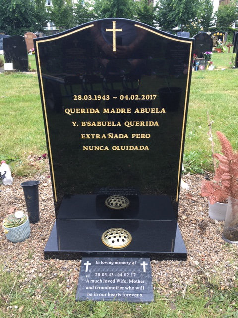 black joggle type memorial with gold pinline & cross