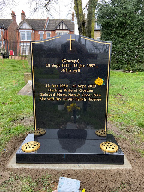 black granite memorial with gold keyline & cross