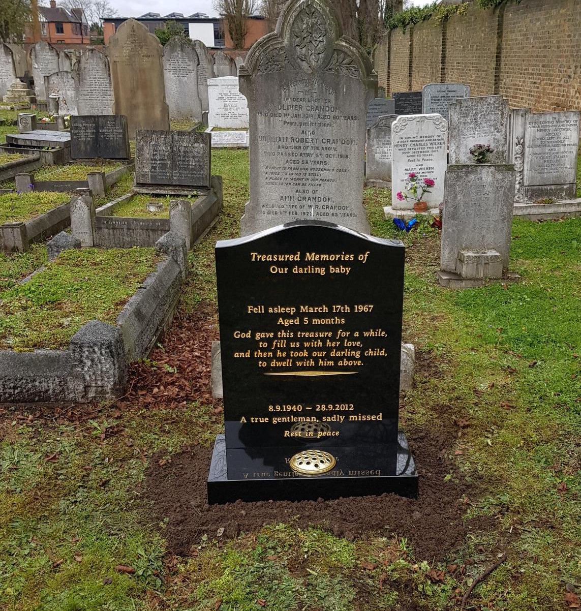 small black granite lawn memorial