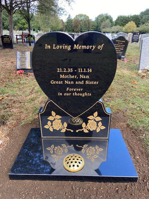 black granite heart memorial with gold roses