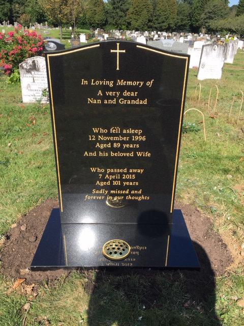 black granite lawn memorial with gold pinline & cross
