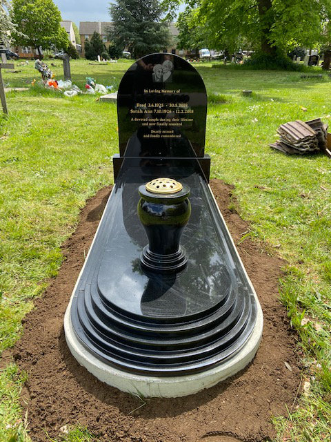 MB138 in black granite with etched photo