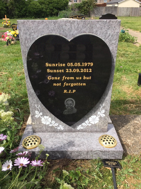 Ice blue & black granite memorial with heart