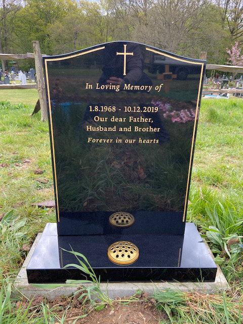 MB102 in black granite with gold keyline & cross
