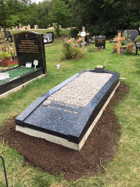 NM209 low rise memorial in blue pearl granite