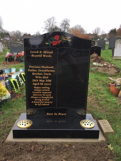 book design on black granite memorial