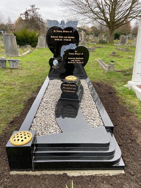 triple heart memorial in black granite with hand carved roses