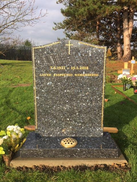 blue pearl granite headstone with gold pinline & cross