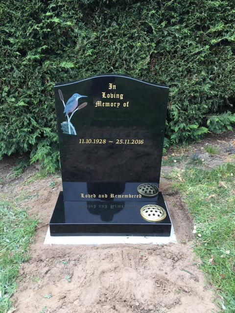 black granite headstone with kingfisher
