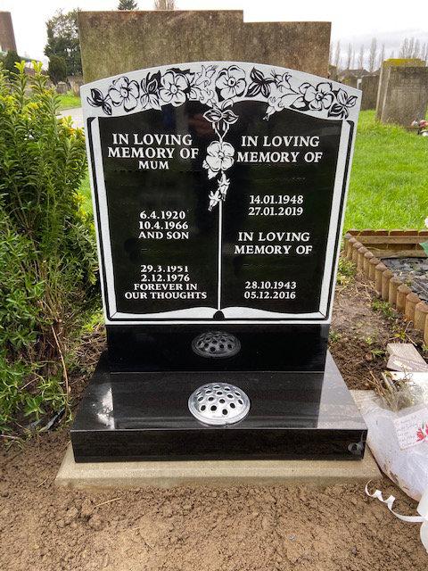 sandblasted book design on black granite headstone