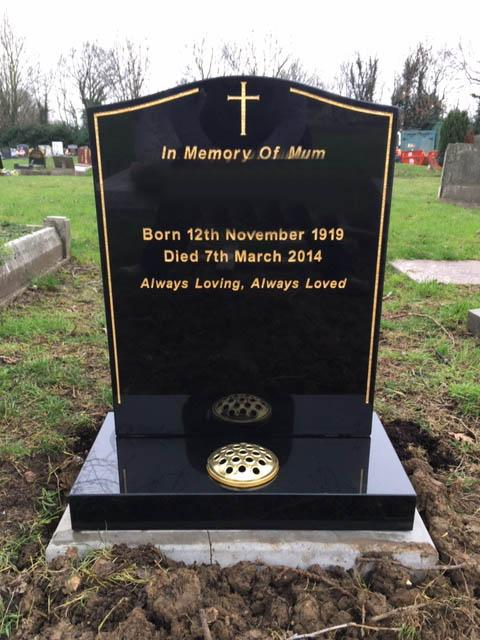 black granite lawn memorial with gold keyline & cross