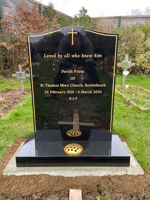 black granite headstone with gold pinline & cross