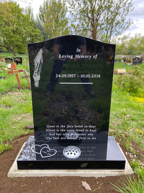 Black Granite Memorial With Etched Hands