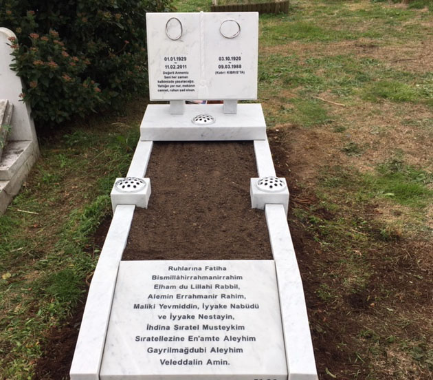 white marble open book memorial with inscription panel