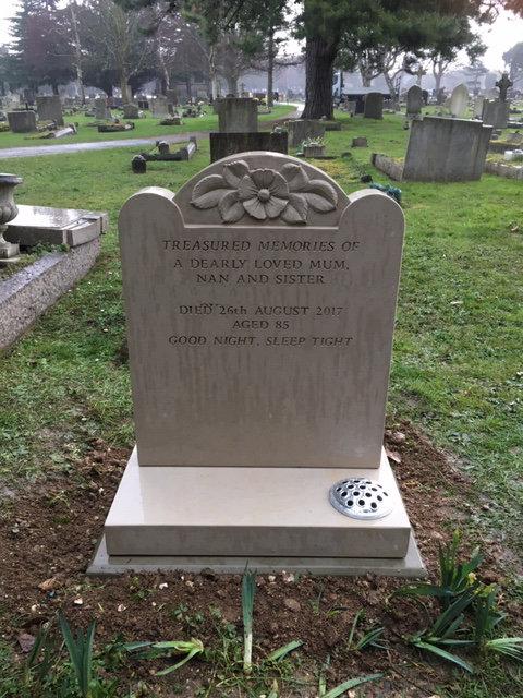 Portland stone memorial with carved poppy
