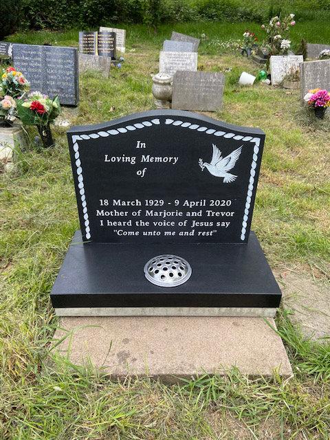 Honed cremation memorial in black granite